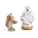 main view of Antique Porcelain Charm Pendants, one of a squirrel and the other depicting lovebirds