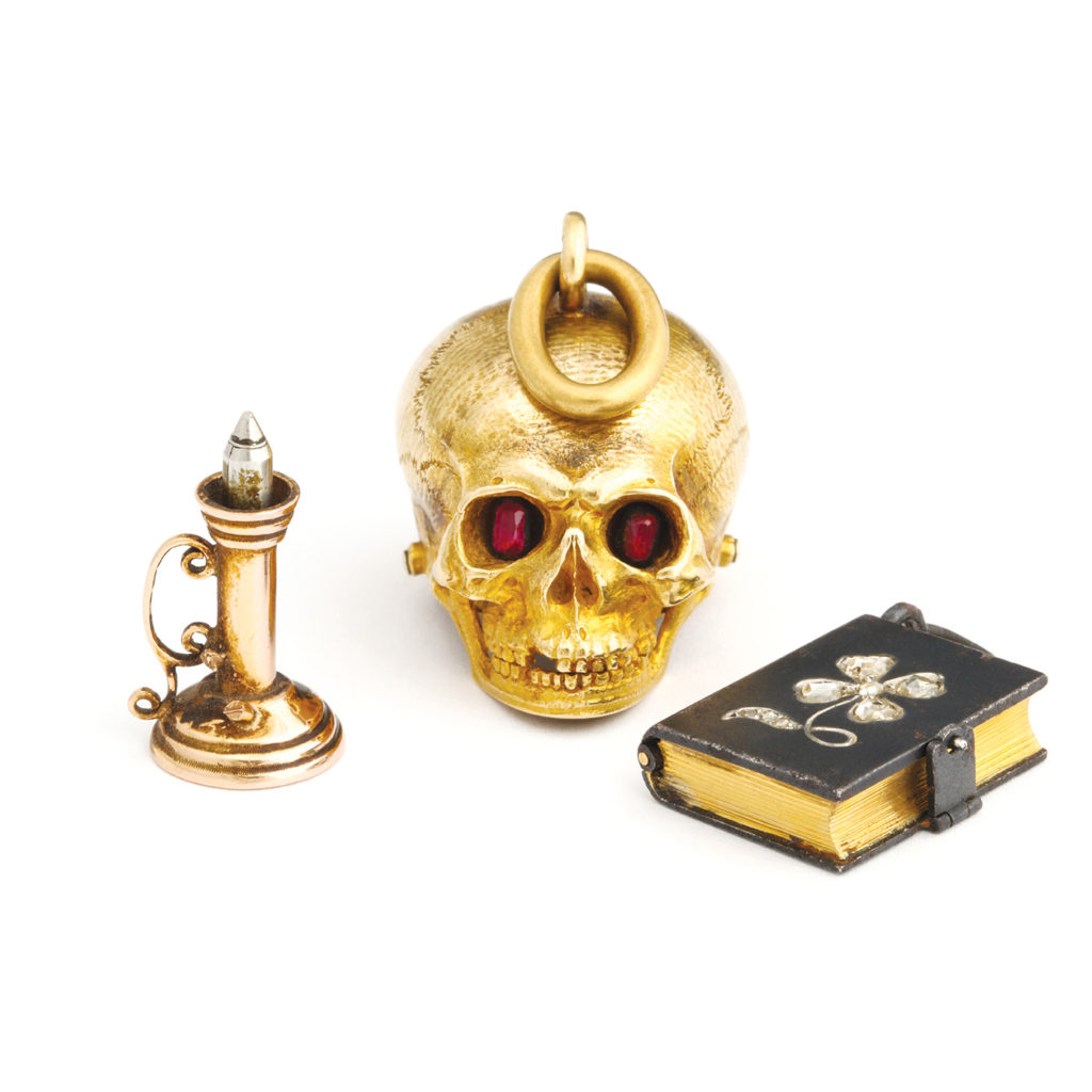 main view Antique Gold Charm Pendants depicting a candlestick, skull, and a book