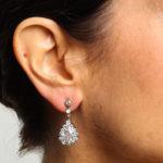 Model wearing Diamond Festoon Pendant Earrings