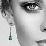 Model wearing black opal and diamond earrings by Marcus & Co.