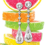 antique diamond tear drop earrings behind stacked candy fruit slices