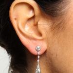 Model wearing Antique Diamond Tear Drop Earrings