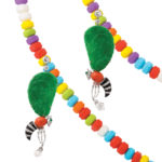 Contemporary jade wasp earrings hanging from candy necklace