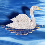 Vintage 1920s Diamond Swan Brooch pictured swimming in water