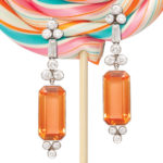 Art Deco topaz and diamond pendant earrings hanging from big swirly lollipop