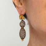 Model wearing Victorian Gold and Woven Hair Pendant Earrings