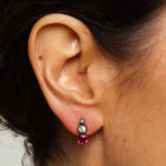 Model wearing Victorian Ruby and Diamond Drop Earrings