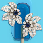 Mid-century Sapphire and Diamond Floral Clip Earrings pictured with a blue popsicle