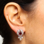 Model wearing 1930s Pigeon Blood Ruby and Diamond Earrings