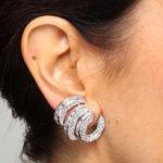 Model showing one way to wear these 1950s Diamond Triple Scroll Earrings