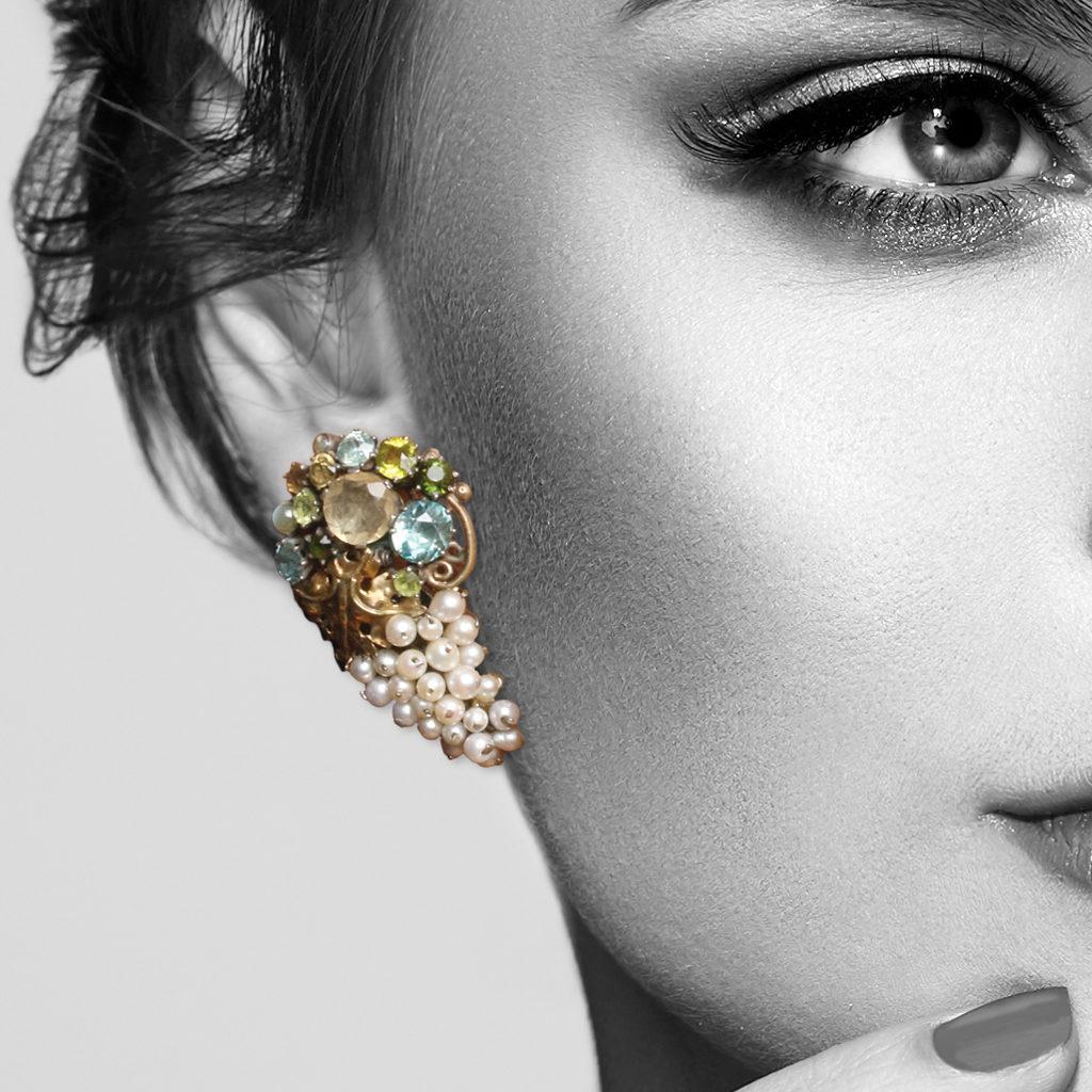Model wearing seed pearl and multigem earrings by Dorrie Nossiter