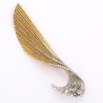 main view, platinum, gold, and diamond feather brooch by Pierre Sterle featured in JCK article