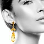 Model wearing victorian citrine pendant earrings