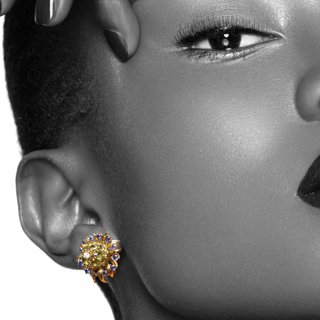 model wearing peridot, sapphire, and diamond earrings by Schlumberger for Tiffany & Co.