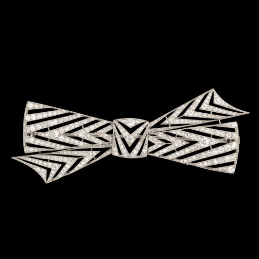 Diamond Bow Brooch by Janesich on black background