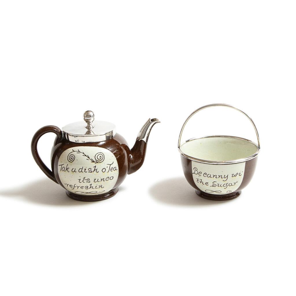 main view, Fabergé Scottish Cumnock Pottery Motto Ware Teapot and Sugar Bowl