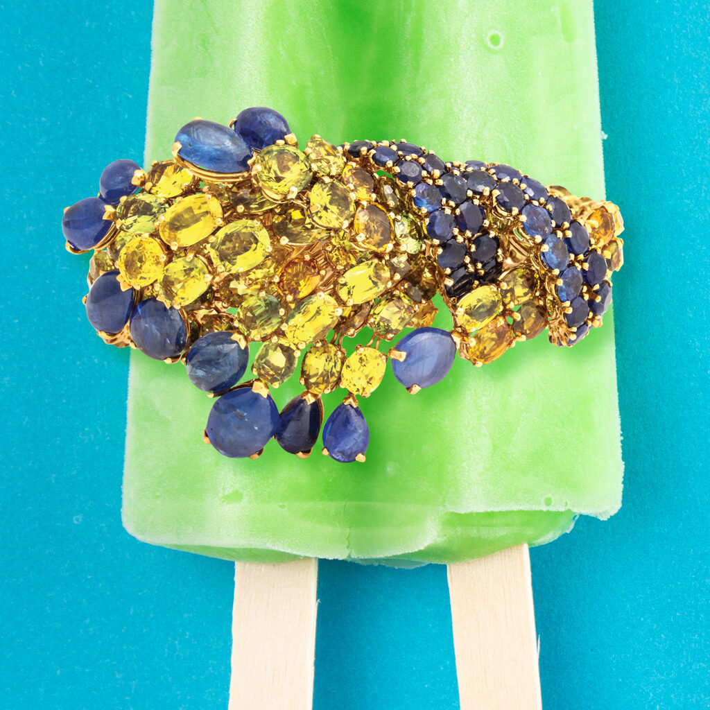 Vintage 1970s Sapphire and Citrine Bracelet on a green popsicle with a blue background