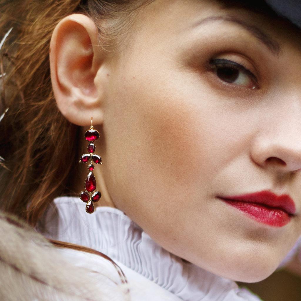 Model wearing antique red garnet pendant earrings