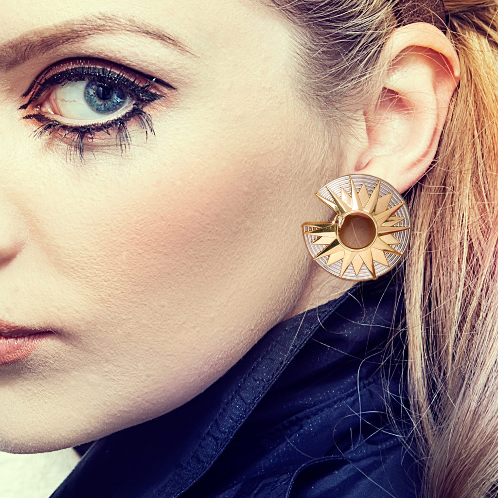 Model wearing 1960s two-color gold c-shaped earrings by Cartier