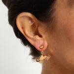 Model wearing antique gold automobile earrings