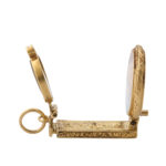 side open view, gold magnifier charm pendant with palace view