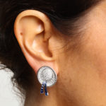 Model wearing Diamond and Sapphire Boater Hat Earrings by Drayson